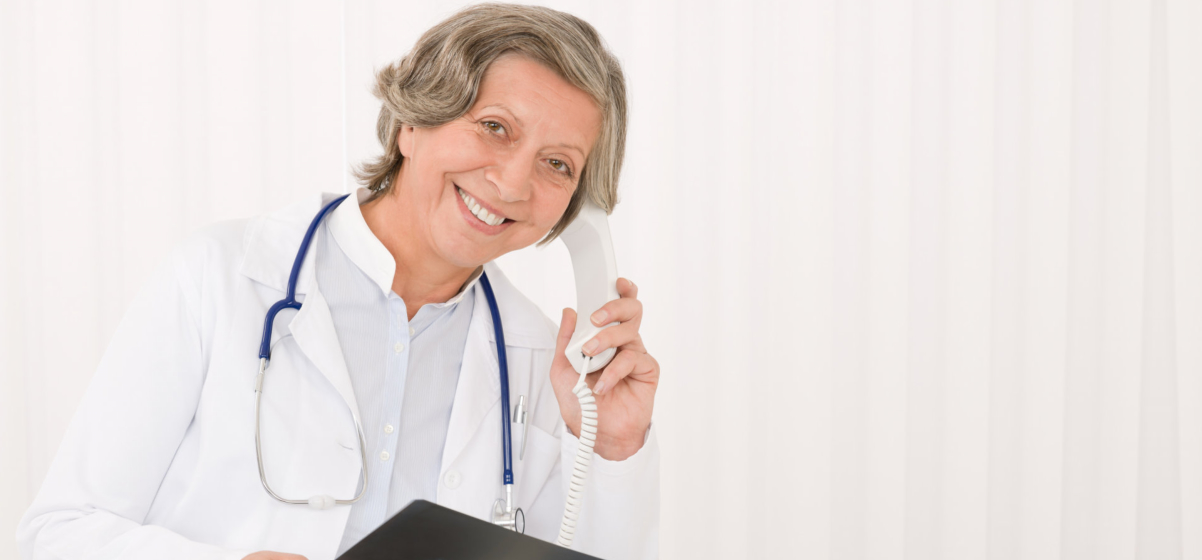A doctor using a telephone